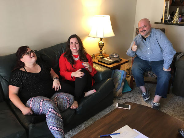 From left, Niki Ilse, Kelly Best and Sean Bunn in Sean's living room. (Lynn Jolicoeur/WBUR)