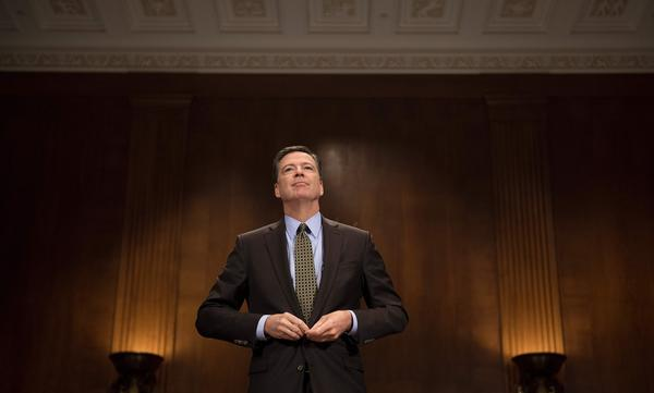 FBI Director James Comey prepares to testify before the Senate Judiciary Committee on Capitol Hill on Wednesday.