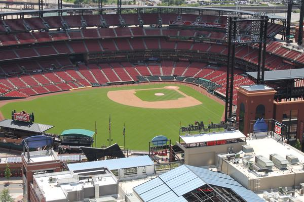 St. Louis police are investigating how a stray bullet struck a woman at Busch Stadium on Tuesday.