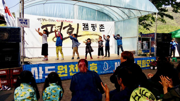 Children dance and sing anti-THAAD slogans at a protest camp near the new U.S. missile defense system in southeast Korea. Residents oppose THAAD, as do about half of all South Koreans.