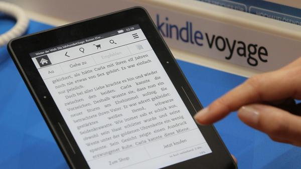 A reader handles an Amazon Kindle at a book fair in Frankfurt, Germany, in 2015.