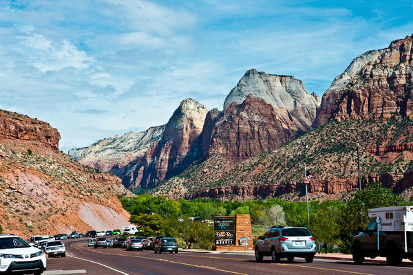 Cars line up at the south entrance to Zion National Park in Utah, bringing with them the urban soundscape.