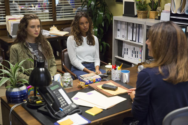 Actress Katherine Langford (left), who plays Hannah, a high school student who kills herself after enduring much bullying, and actress Alisha Boe (Jessica) sit in the counselor's office on <em>13 Reasons Why</em>.