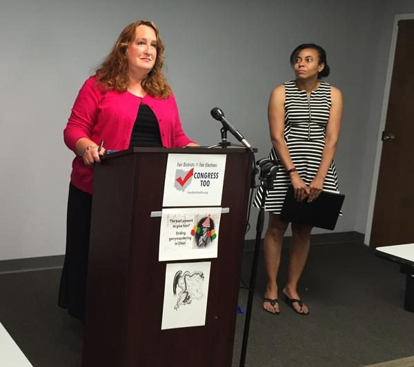 Catherine Turcer announces the effort to change the way Congressional districts are drawn at a press conference in July 2016.