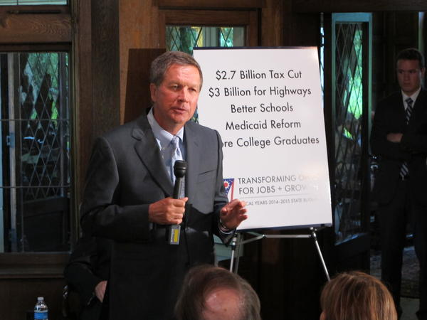 Gov. John Kasich goes over the details of the state budget in June 2013. That budget included a small business tax cut that's now the third largest tax break in the state budget.