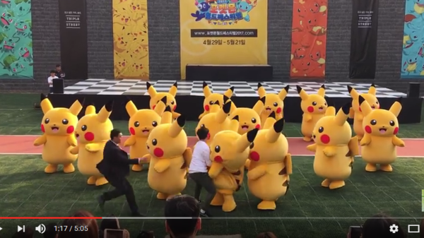 A video of a dancing Pikachu getting tackled by men in suits in Songdo, South Korea went viral on Friday.