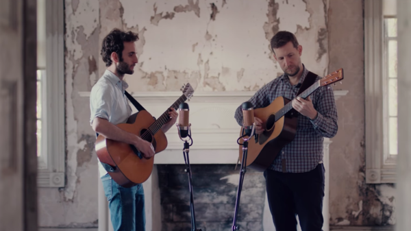 "Julian Lage & Chris Eldridge in a still from their video for ""Bone Collector."""