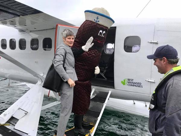 Victoria Mayor Lisa Helps and Mr. Floatie board a seaplane to fly to Seattle for the sewage treatment mascot's official retirement party.