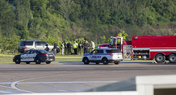 Emergency officials work near the site of a fatal plane crash at Yeager Airport in Charleston, W. Va., Friday, May 5, 2017.