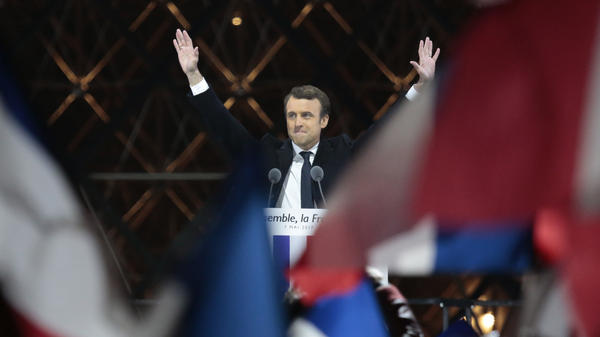 Emmanuel Macron acknowledges supporters at the Louvre on Sunday after winning the French presidential election. Pro-EU centrist Macron defeated far-right rival Marine Le Pen by a comfortable margin.