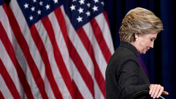 Hillary Clinton steps down a staircase on Nov. 9 after making a concession speech following her defeat to Republican Donald Trump.