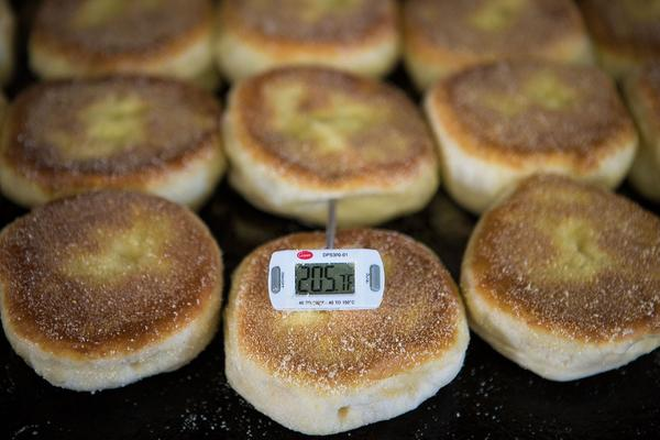 In this 2015 file photo, a thermometer shows an internal temperature of 205 degrees, before pulling English muffins off the grill. (Jesse Costa/WBUR)