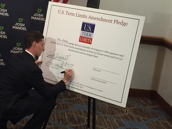 Republican Ohio Treasurer Josh Mandel signs pledge to support a bill in Congress to implement term limits.