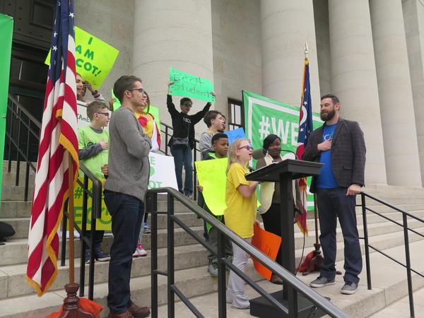 Nine-year-old Hannah Sims of Wapakoneta leads the pledge of allegiance.