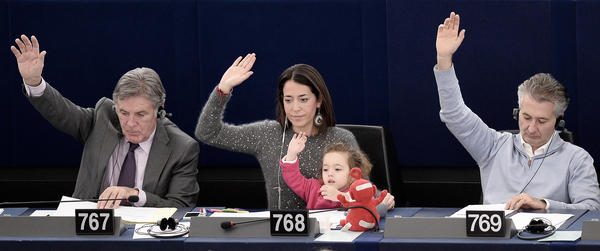 Italian politician Licia Ronzulli, along with her daughter Vittoria, takes part in a vote during a plenary session of the European Parliament in 2013.