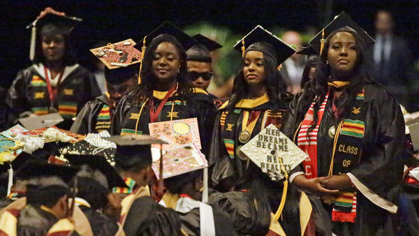 Students stand and turn their backs on DeVos during her commencement speech at Bethune-Cookman on Wednesday.