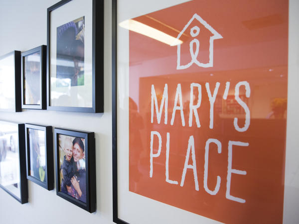 A Seattle motel converted into a homeless shelter is being torn down, but the shelter will find a permanent home in a new six-story Amazon office building. Above, a sign for the Mary's Place shelter adorns a wall in the former motel in May 2016.