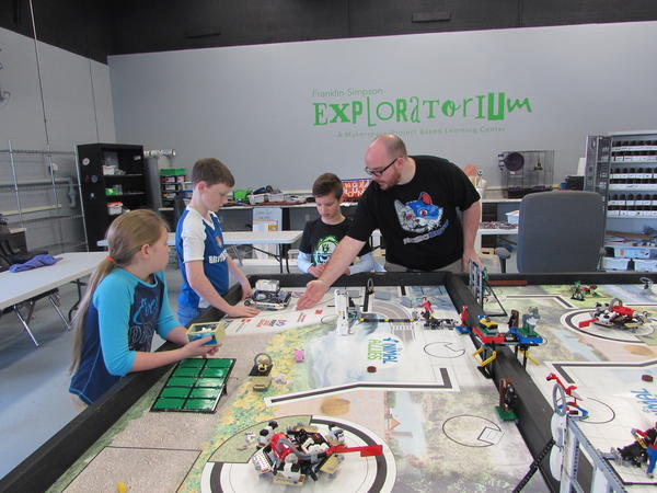 Matt Staggs, science resource teacher for Simpson County Schools, with robotics camp students, left to right, Natalie Simmons, Michael McGee and Garret Bidwell.