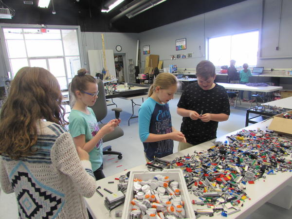 Lots of Legos are available to work with at the Exploratorium. Left to right are Isabelle Herndon, Charlotte Hargrove and Natalie Simmons.