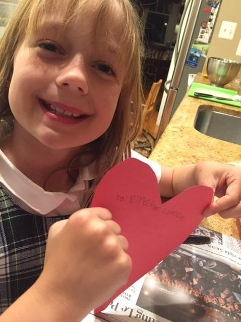 Nine-year-old Abby Grace holds up the card she made to go along with the cookies she delivered to former FBI Director James Comey.
