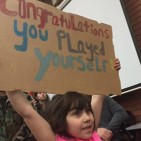 A young protester at Kennewick City Hall, where councilman Bob Parks defended himself at the first council meeting after his Facebook comments on Latinos of Yakima and Pasco.