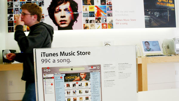 A 2003 display for the iTunes Music Store ushers in a new age for the music business, shortly after its introduction. The iPod helped turn around Apple's fortunes and brand identity, while the creators of the MP3 had regarded a portable player as a mere storage device.