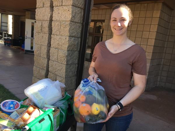 Kara Dethlefsen, 27, an active duty Marine, attends the monthly food pantry at the Camp Pendleton Marine Corps Base near San Diego. Her husband is also a Marine and she said the food assistance helps them get ready for his transition to civilian life.