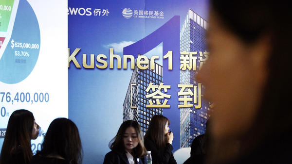 Chinese staff wait for investors at a reception desk during an event promoting a Kushner Companies development in Shanghai on Sunday. Nicole Kushner Meyer, sister of Jared Kushner, has canceled an upcoming presentation that had been scheduled for Saturday in Shenzhen.