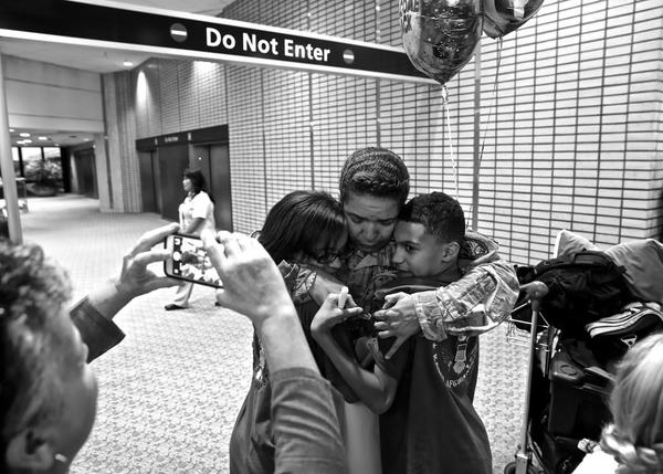 Air Force Master Sgt. Nicol Roldan being greeted by her daughter, Alissa, and son, J.C., at Tampa International Airport as she returned after seven months in Afghanistan.