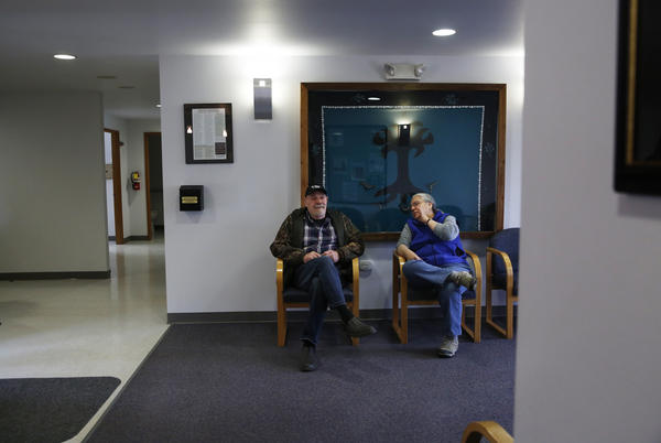 Everett Simons and Lani Hotch chat in the waiting room at the health clinic.