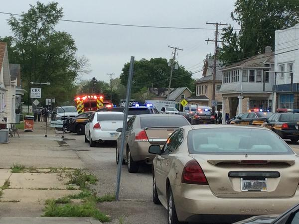 Emergency vehicles crowd Main Street in Kirkersville, Ohio, on Friday morning, after a shooting at a nursing home that left four dead, including the town's police chief.