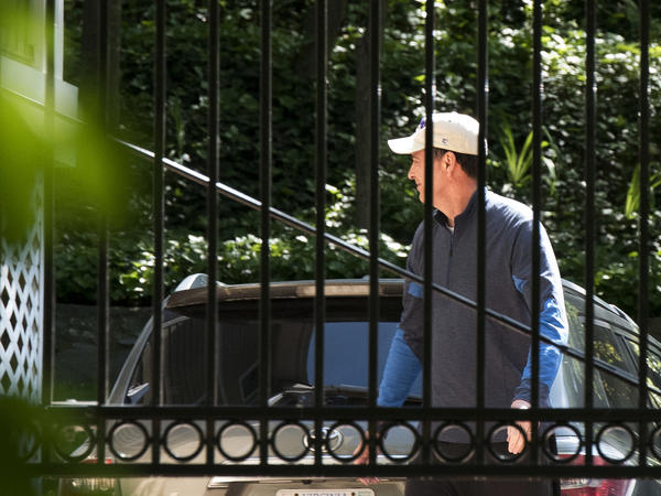 Former FBI Director James Comey walks outside his home in McLean, Va., on Wednesday.