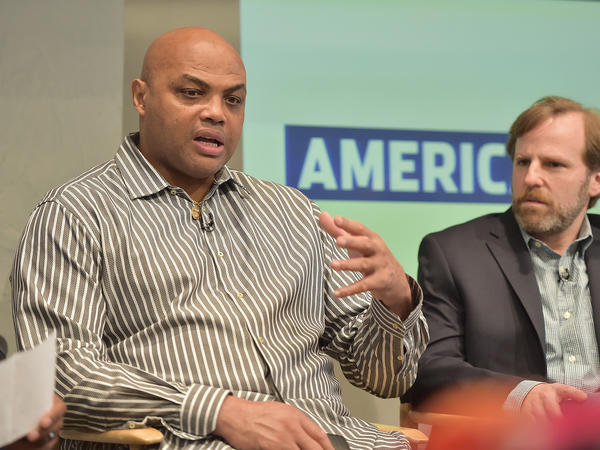 Charles Barkley and executive producer Dan Partland speak during the American Race Press Luncheon in May in New York City.