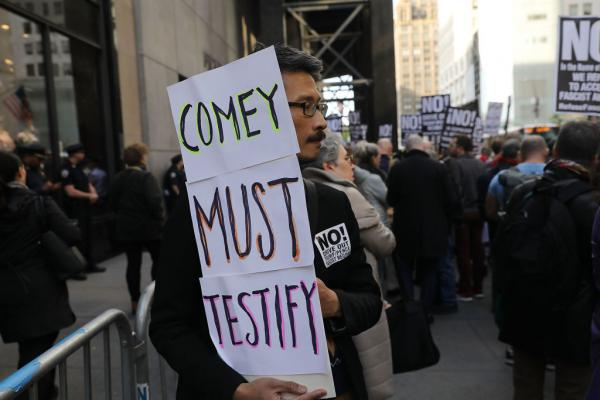 Protesters gather outside of Trump Tower in New York City a day after FBI Director James Comey was fired by President Donald Trump.