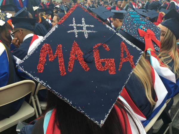 One of President Trump's trademark Twitter hashtags is seen at Liberty University's commencement ceremony Saturday in Lynchburg, Va.