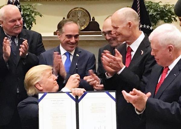 President Trump after signing the Veterans Choice Program Extension and Improvement Act, April 19, 2017. From right to left: Florida VA Ex. Dir. Glenn Sutphin, Florida Gov. Rick Scott, Chairman U.S. House VA Committee Phil Roe, VA Secretary David Shulkin.