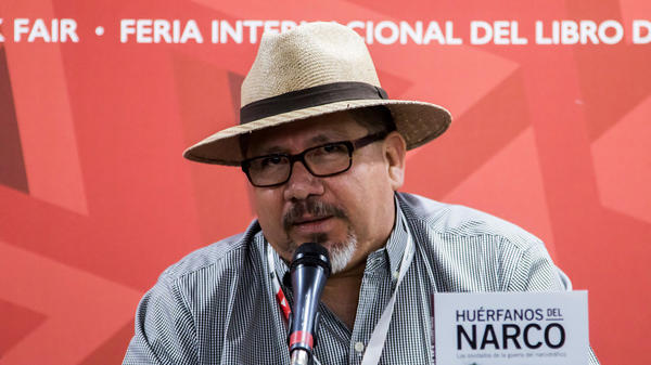 Mexican journalist Javier Valdez speaks at the International Book Fair in Guadalajara, Mexico, in 2016. He was killed by a gunman on Monday.