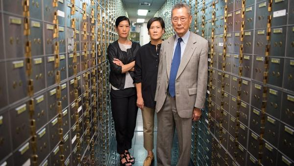 Vera Sung, Jill Sung, and Thomas Sung in <em>Abacus: Too Small To Jail</em>.