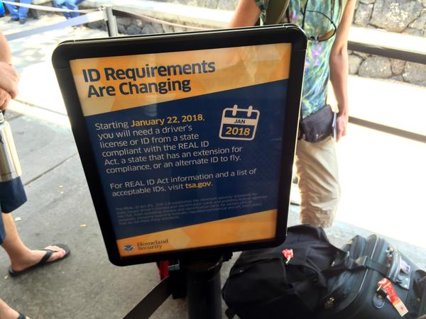 Signs like this one in Kona, Hawaii, are popping up at TSA airport security checkpoints around the country to warn travelers about tougher ID requirements.