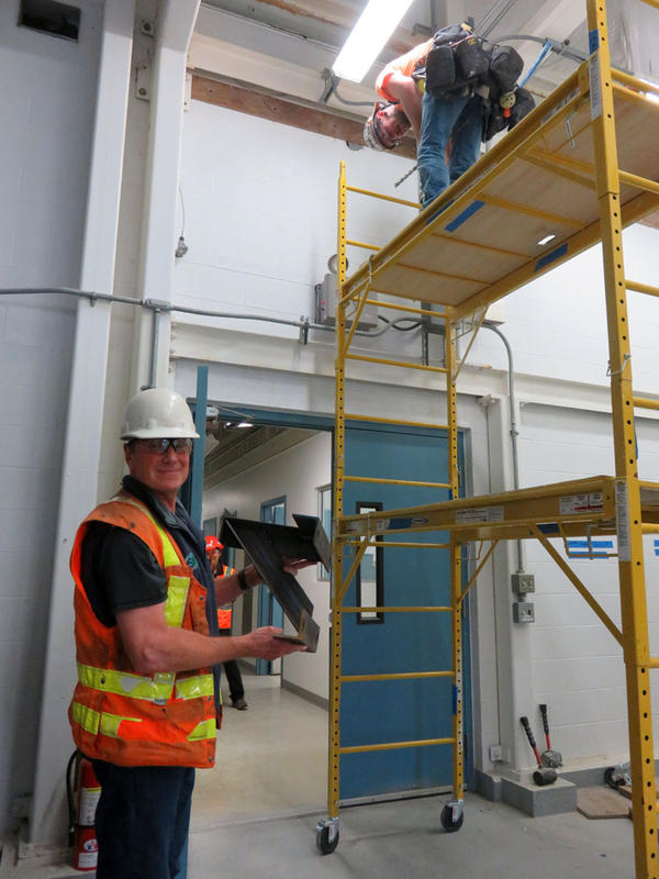 Contractor at work preparing to brace the walls and ceiling joints to earthquake-proof the operations building at Everett's drinking water filtration plant..