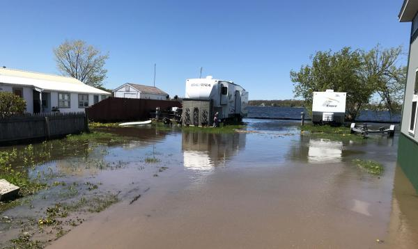Marina owner Cathy Goodnough shut down the family resort park last week after continued flooding in Sandy Pond placed some mobile homes and docks under water.