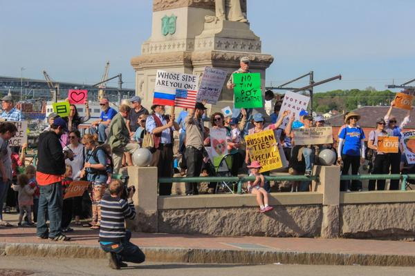 Several dozen people came out to protest President Trump at New London's Soldiers and Sailors Memorial Park on Tuesday. The President is to deliver the commencement address at the U.S. Coast Guard Academy in New London on Wednesday.