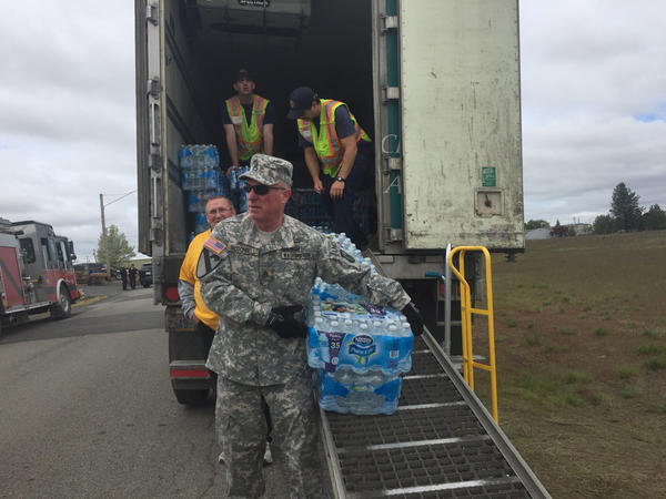 Flats of water were passed out to residents of Airway Heights, Washington, Wednesday while residents were told it could be days before drinking tap water is advised.