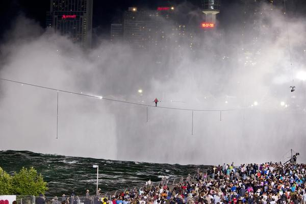 Nik Wallenda walks into the mist over Niagara Falls.