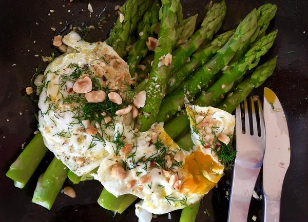 Kathy 's steamed asparagus with fried eggs, brown butter and a dill-lemon sauce. (Kathy Gunst for Here & Now)