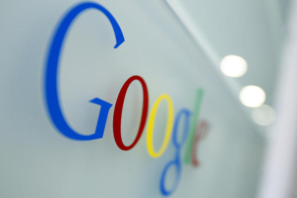 In this file photo, the Google logo is seen at the Google headquarters in Brussels. (Virginia Mayo/AP))
