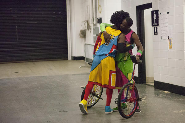 Unicyclists hug backstage before a performance in Baltimore.