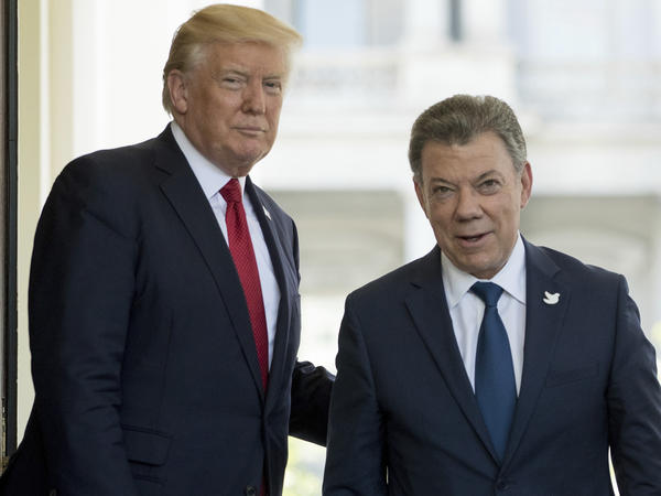 President Trump greets Colombian President Juan Manuel Santos as he arrives at the White House on Thursday.