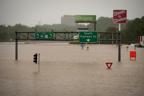 Highway exit signs are submerged in floodwater on Highway 141 in Valley Park, Missouri. Flooding hit towns along the Meramec River this month after days of rainfall.