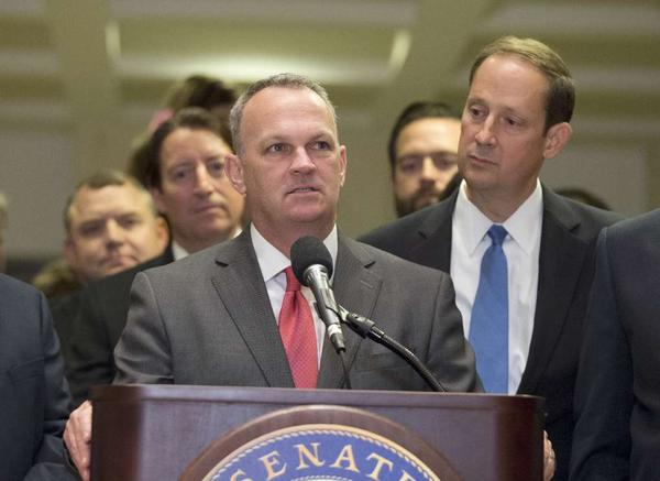 Florida House Speaker Richard Corcoran, left, and Senate President Joe Negron talk to the press at the end of the legislative session on May 8